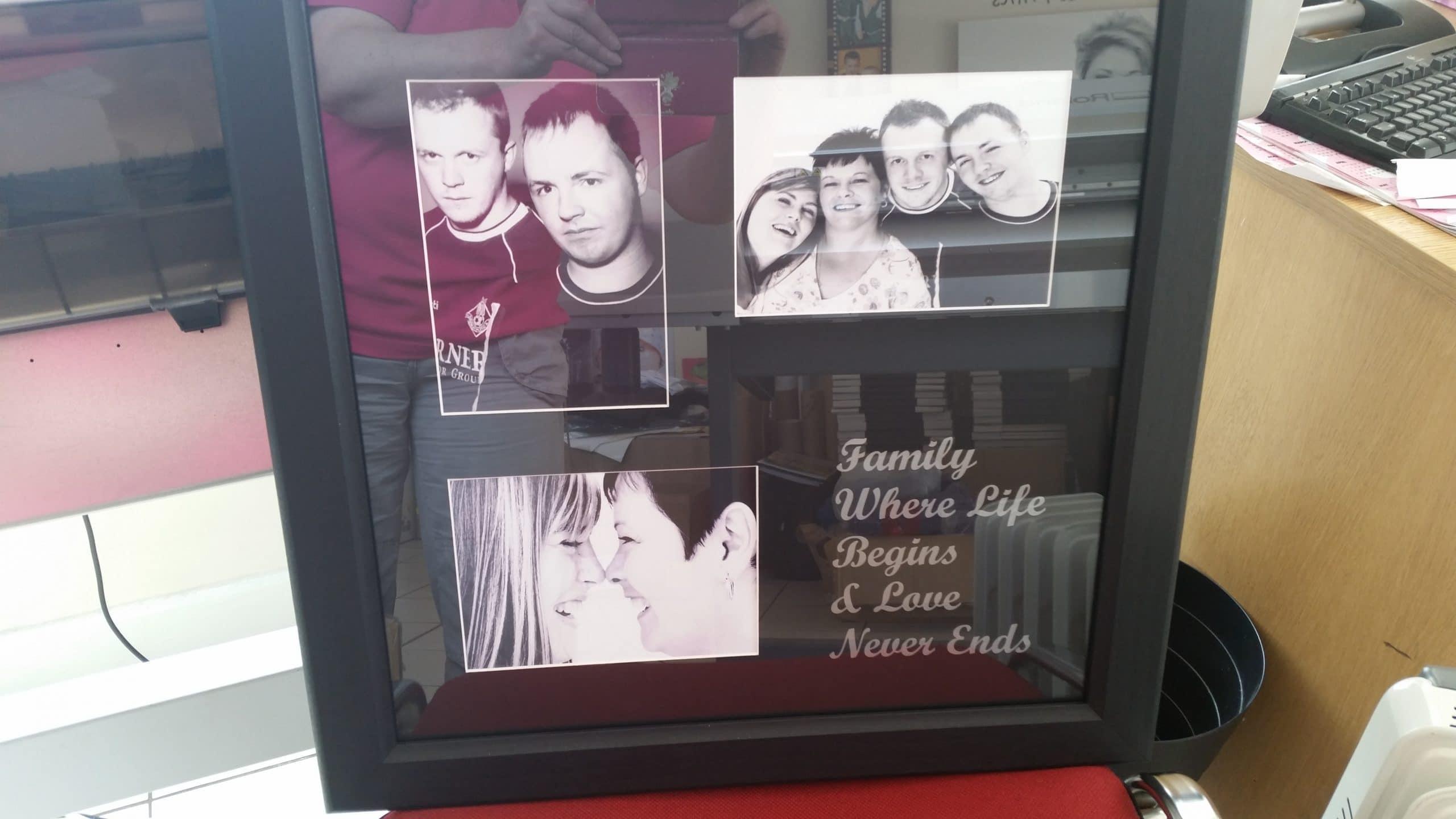 Family Photograph Framed in Black With Vinyl Lettering