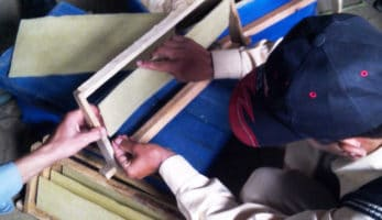 man assembling a picture frame
