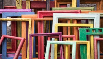 multi coloured picture frames leaning against each other