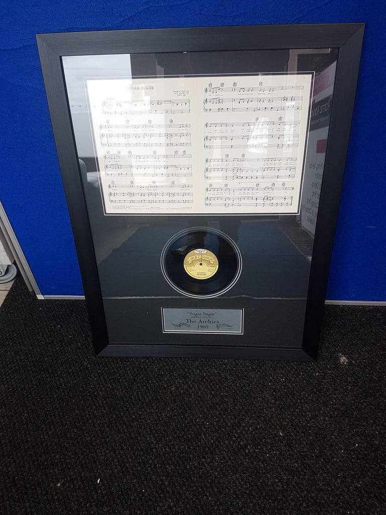 Framed Memorabilia of The Archies, North West Picture and Sports Framing