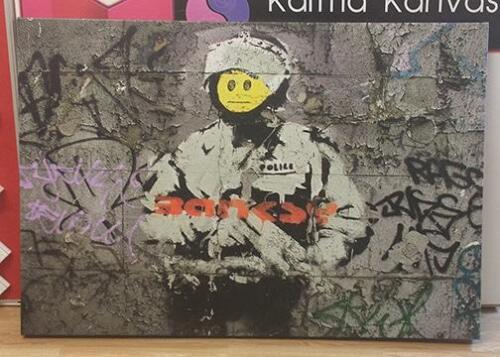48 x 36 inch Bansky canvas print.