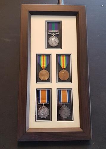 Framed war medals