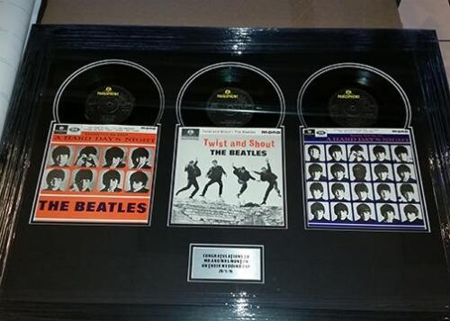3 framed Beatles singles