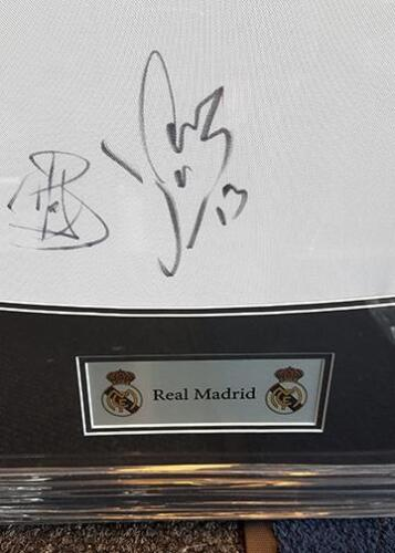 Example of plaque on framed football shirt