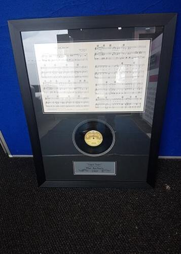 Framed single and song sheet by The Archies