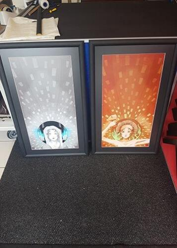 A pair of graphics framed for student customer