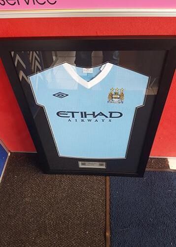 Framed Man City football shirt